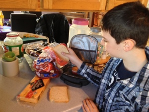 9-year-old John has been making his lunch each morning for a couple of years.