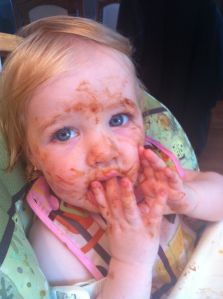 "My niece Lily at 12 months ""enjoying"" some spaghetti"