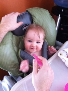 My niece Lily gets her first taste of solid food at 6 months of age