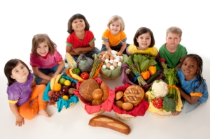 Healthy Eating: Diverse Group Children Food Group Baskets High Angle